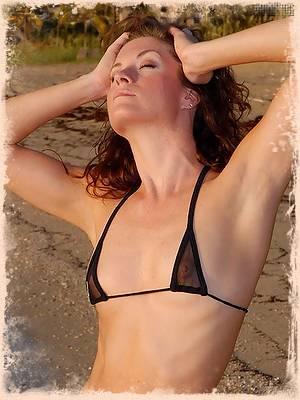 Gorgeous babe Candace in a tiny black bikini
