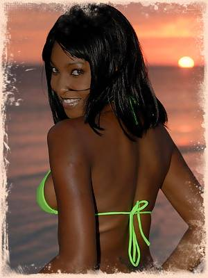 Samone poses in a sheer lime green bikini