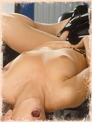Pornstar Luna Lane is a hot redhead posing naked in black heels