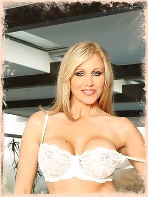 Julia Ann busty blond milf spreads pussy