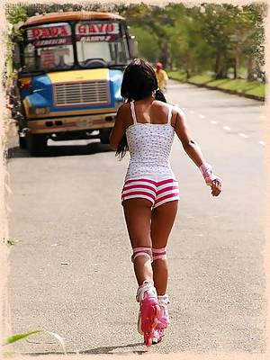 Gigi roller blades around town in booty shorts