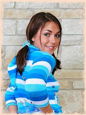 Taylor Lain looks cute in a sweater and panties