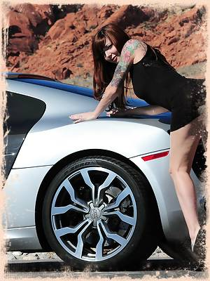Ivy Snow finds a lonely road to take some nude pictures with an exotic car