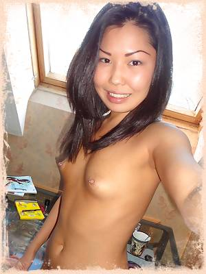 Skinny asian girl friend uses her computer nude